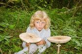 Girl with giant parasol mushroom — Stock Photo