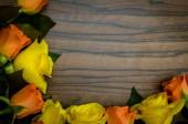 Yellow and orange roses background — Stock Photo