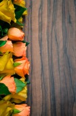 Yellow and orange on wooden background — Stockfoto