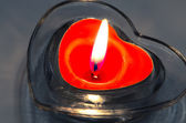 Red heart candle decoration — Stock Photo