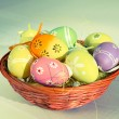 Colorful easter eggs in basket retro effect — Stock Photo #66996431