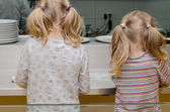Children cooking rear view — Zdjęcie stockowe