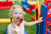 Girl eating ice lolly — Stock Photo