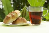 Sesame and garlic bread with Hot Tea  — Stock Photo