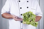 Chef holds lettuce  — Stock Photo