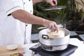 Chef opening lid of basket bamboo — Stock Photo