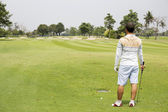 Golfer looking — Stock Photo