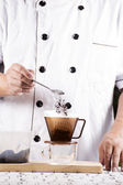 Put grinded cofffe into filter cup — Stock Photo