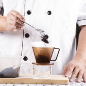 Putting grind cofffe into filter cup — Stock Photo