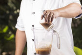 Chef putting coffee to blender — Stock Photo