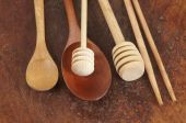 Wooden spoons on a timber board — Stock Photo
