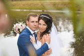 Bride and groom. City Quay. River. — Stock Photo