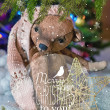 Christmas card with teddy bear, Christmas tree, ornaments, gold glitter, fir branches and greeting text. — Stock Photo #59692561