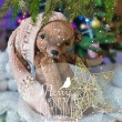 Christmas card with teddy bear, Christmas tree, ornaments, gold glitter, fir branches and greeting text. — Stock Photo #59692625