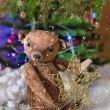 Christmas card with teddy bear, Christmas tree, ornaments, gold glitter, fir branches and greeting text. — Stock Photo #59692791