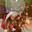 Christmas card with teddy bear, Christmas tree, ornaments, gold glitter, fir branches and greeting text. — Stock Photo #59693039
