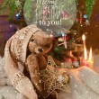 Christmas card with teddy bear, Christmas tree, ornaments, gold glitter, fir branches and greeting text. — Stock Photo #59693143