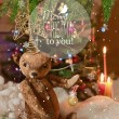 Christmas card with teddy bear, Christmas tree, ornaments, gold glitter, fir branches and greeting text. — Stock Photo #59693357