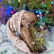 Christmas card with teddy bear, Christmas tree, ornaments, gold glitter, fir branches and greeting text. — Stock Photo #59693491