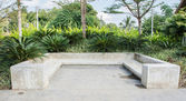 Modern concrete bench in garden — Stock Photo