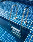Stairs of the empty swimming pool — Stock Photo