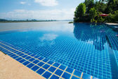 Swimming pool near Khong river with blue sky ,Chiangsan in Chiangrai ,Thailand — Stock Photo