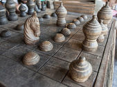 Ancient Thai wooden chess were lined on the board — Stock Photo