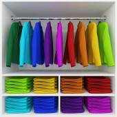 Colorful clothes hanging and stack of clothing in wardrobe — Stok fotoğraf