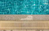 Swimming pool and gutter water overflow and sand wash terrace — Stock Photo