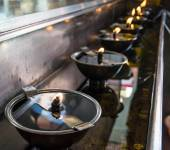 Row of incense burne — Stock Photo