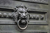 Old ironwork lion knocker — Stock Photo