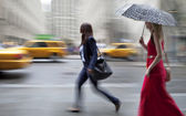 Rainy day in the city on motion blur — Stock Photo