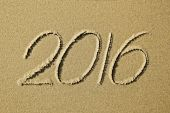 2016 year written on the beach sand — Stock Photo