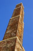 Square old Industrial chimney made from red bricks against the b — Stock Photo