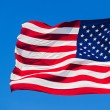 American flag on the blue sky — Stock Photo #76914185