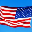 American flag on the blue sky — Stock Photo #76915465