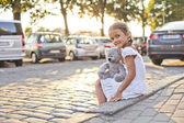 Young lonely girl on a city street — Stock Photo