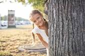 Young girl playing at a park — Stok fotoğraf