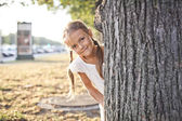 Young girl playing at a park — Stock Photo