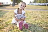 Sad child in a park — Stock Photo