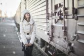 Stylish woman in snowy day on a platform — Stock Photo