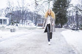 Blonde girl in the park on a winter day — Stock Photo