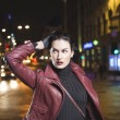 Woman is going out shopping in a night city — Stock Photo #68979431