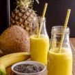 Pineapple, Banana, Coconut, Turmeric and Chia Seed Smoothies — Stock Photo #67540547