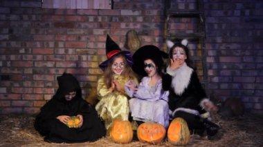 Children in Halloween costumes with pumpkins — Stock Video