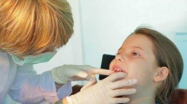 Little girl at the dentist — Stock Video