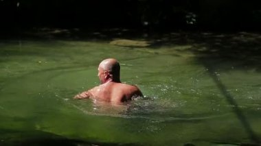 Man Swimming In River — Stock Video