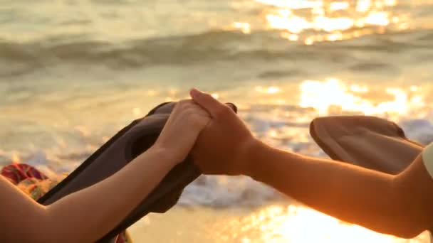 Loving Couple Holding Hands While Sitting On Outdoor Chairs At Beach — Vídeo de stock