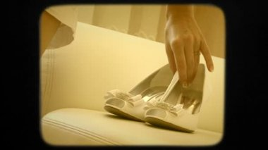 Bride Taking Wedding Shoes Off The Sofa — Stock Video
