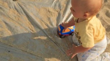 Small Baby With Toy Crawling On Cloth — Stock Video